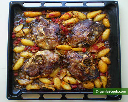 Baked Lamb's Head with Potatoes on a Baking Sheet