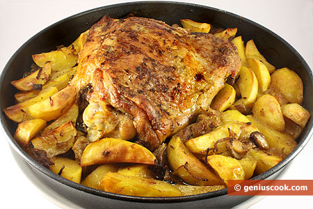 Baked Turkey Leg with Potatoes and White Mushrooms