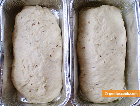 the dough into pre-oiled forms