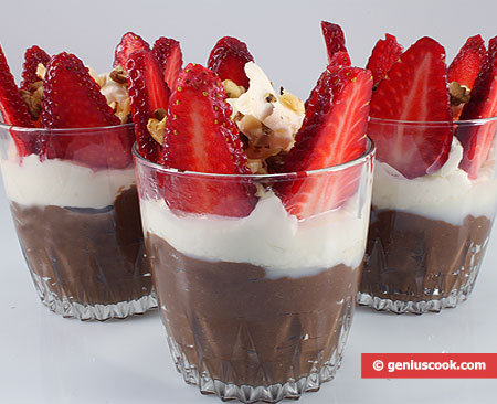 Chocolate pudding with whipped cream and strawberries