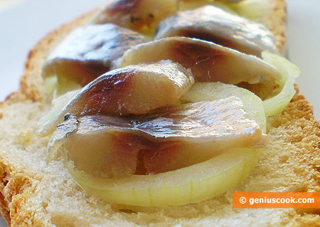 Ready salted sardines with onions on bread
