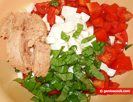 tomatoes cut into cubes, mozzarella, finely chopped olives, basil