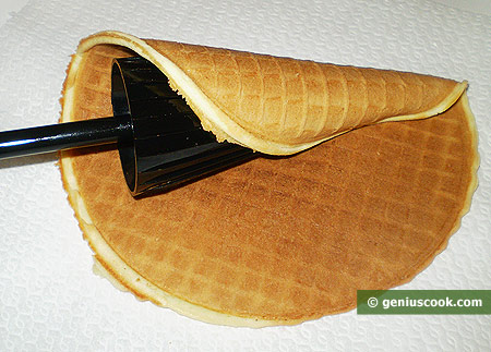 Roll up hot wafers into a cone