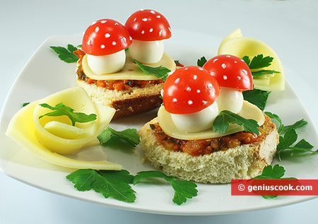 Canape with Quail eggs, Cheese and Tomatoes