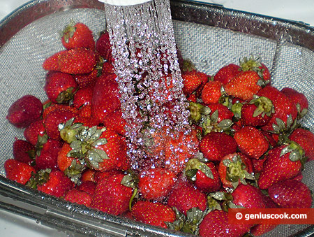 Wash strawberry in running water