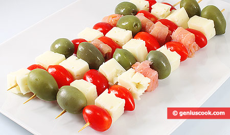 Snack with Tomatoes, Cheese and  Salmon on Skewers