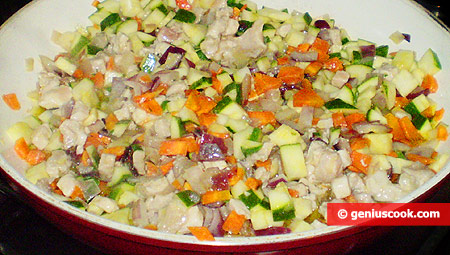 Add meat, carrot and zucchini