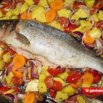 Fish on a baking tray with vegetables