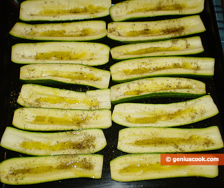 Boats zucchini with oil and basil