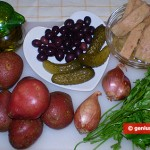 Potato salad with tuna, olives and gherkins