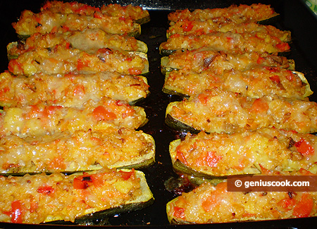 Baked zucchini on a baking sheet