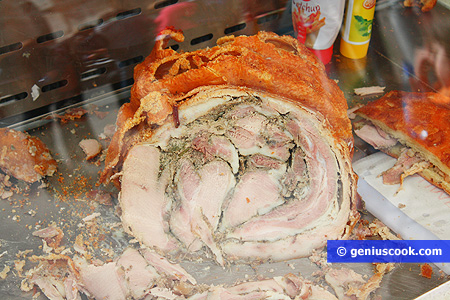 Porketta - piglet roasted over a fire with herbs
