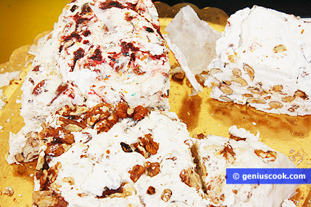 Nougat with different nuts, chocolate, candied fruit-torrone