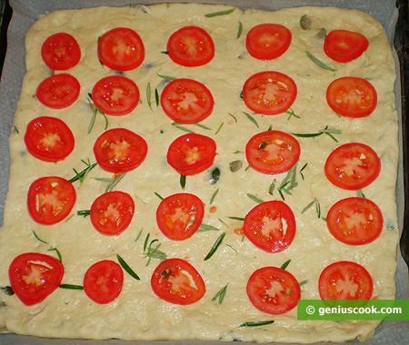 top put thin slices of tomato